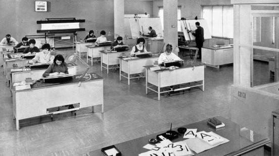 I disegnatori in una foto d'epoca.