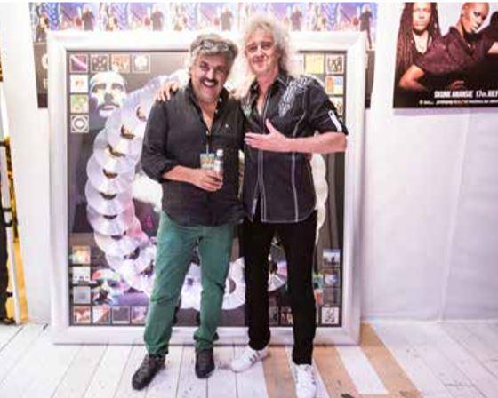 Con Brian May, durante uno dei tour più recenti dei rimanenti Queen.